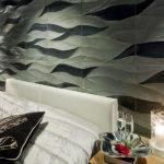 3D-efekti seinälle luonnonkivellä Ambra Black verhoilukivellä